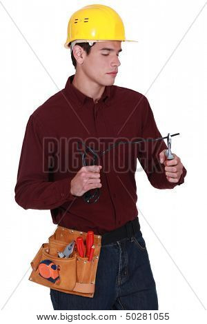 Electrician snipping electrical cable