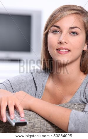 Teen turning the TV on