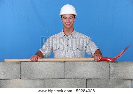 Mason posing by wall