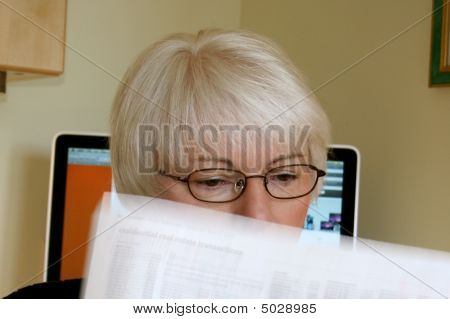 Woman reads news