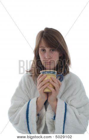 Girl Drinking From A Cup