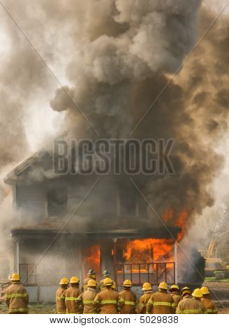 Firemen At A Burning House