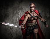 pic of legion  - Wounded gladiator attacking with sword covered in blood - JPG