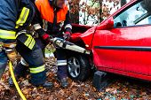 Accident - Fire brigade rescues accident Victim of a car using a hydraulic rescue tool