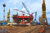 stock photo of scaffolding  - The reconstruction of an oil rig shipyard od Gdansk - JPG