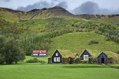 stock photo of iceland farm  - Traditional Icelandic houses with grass roof in Skogar Folk Museum - JPG