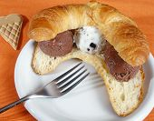 image of gelato  - Croissant or brioches sliced open and served with three scoops of frozen with Italian gelato ice cream - JPG