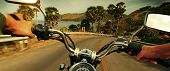 stock photo of pov  - Driver riding motorcycle on an asphalt road in a tropics - JPG
