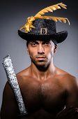 stock photo of ripper  - Ripper pirate in the dark room - JPG