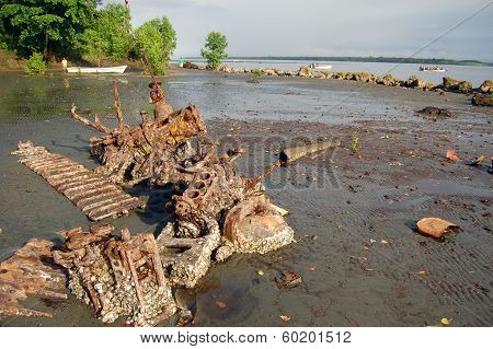 Abandoned Rusty Metal Boat Parts At Low Tide Ocean Coast