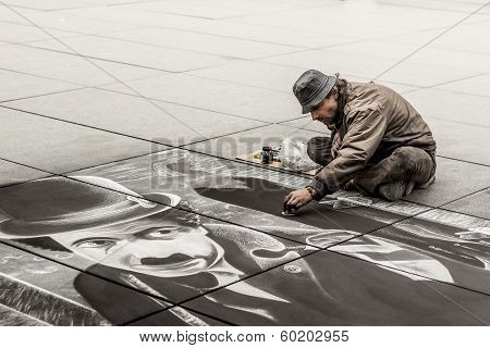 Senior Artist During Drawing Charlie Chaplin - Paris.