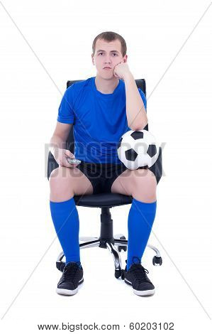 Bored Man In Uniform Sitting With Remote Control And Watching Soccer Game Isolated On White