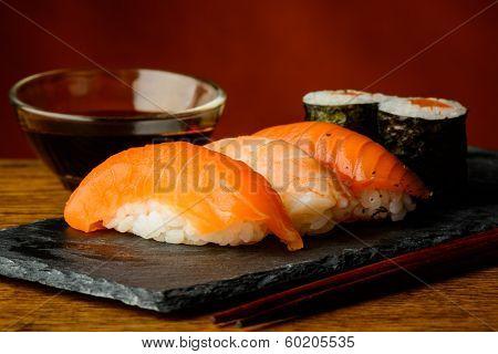 Maki And Nigiri Sushi And Soy Sauce