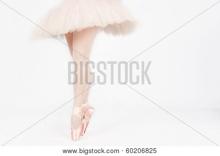 A Ballet Dancer Standing On Toes While Dancing