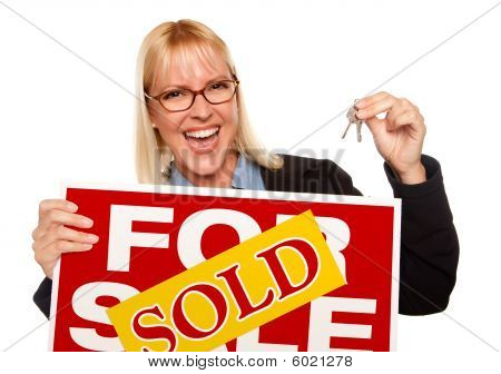 Attractive Blonde Holding Keys & Sold For Sale Sign