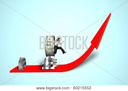 Businessman Jumping Over Money Stacking Obstacle