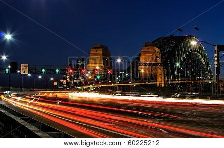 Sydney Harbour Bridge at night with car light trails