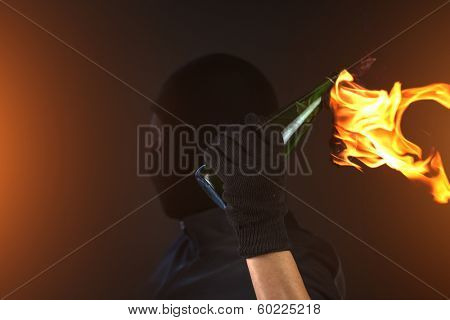 molotov cocktail in activist hand