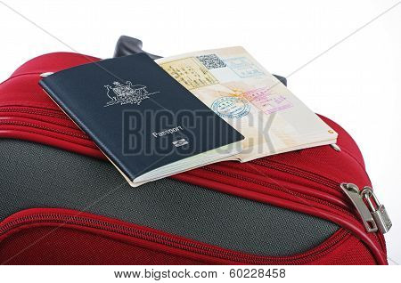 passport and red suitcase