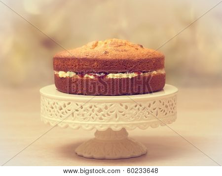 Victoria sponge cake filled with jam and buttercream - antique vintage tone effect added