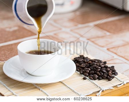 Pour The Coffee Into A Cup
