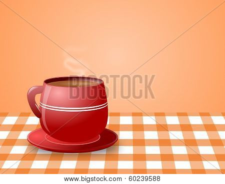 Red Cup Of Steaming Hot Coffee On Check Table