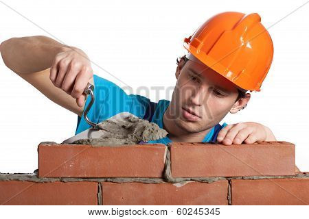 Concentrated Bricklayer Putting