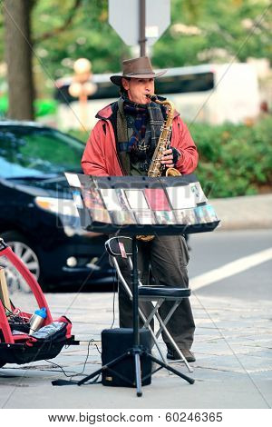 QUEBEC CITY, CANADA - SEP 10: Local artist performs on street on September 10, 2012 in Quebec City, Canada. As the capital of the Quebec, it is one of the oldest cities in North America.
