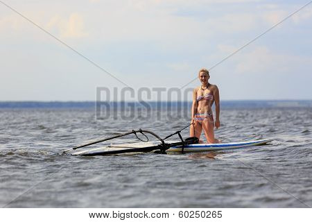 Happy Windsurfer On The Board