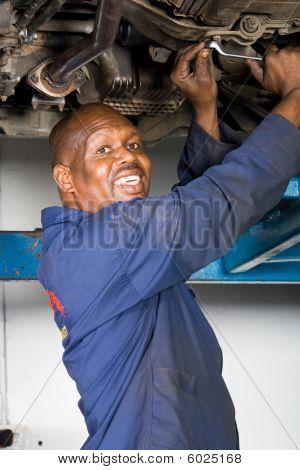 Mechanic working on vehicle