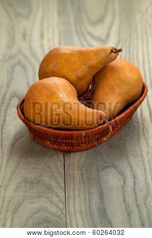 Ripe Pears In Basket On Aged Wood