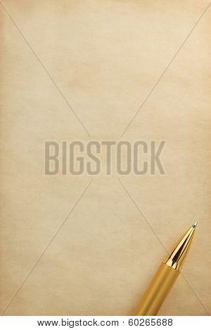 gold pen on parchment background texture