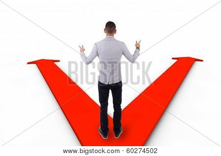 African American Business Man Hesitating Between Two Ways Indicated By Arrows