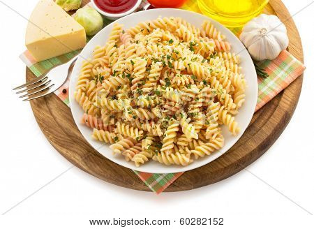 pasta fusilli in plate isolated on white background