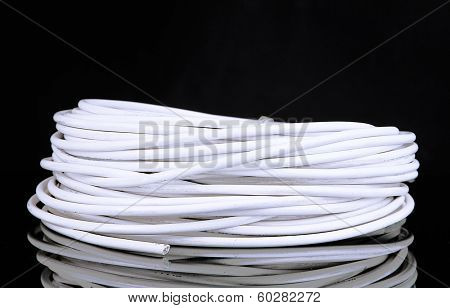 White cable on black background