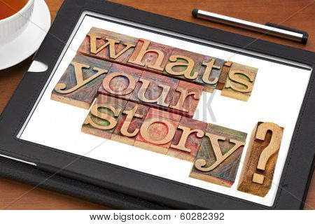 what is your story question in vintage wooden letterpress printing blocks on a digital tablet with a cup of tea