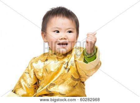 Chinese baby boy with traditional costume and thumb up