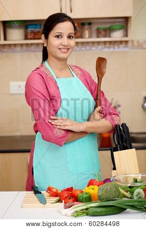 Young Woman With Kitchen Utensil