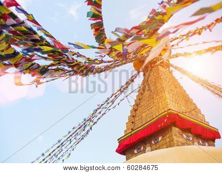 Bodhnath Stupa with Buddha Eyes during sunrise in Kathmandu.