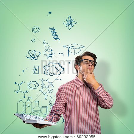 young scientist holding a book