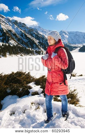 Young Woman Take A Walk On Winter Mountain Slope (big Almaty Lake, Kazakhstan)