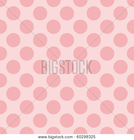 Seamless pastel vector pattern with dark pink polka dots on a sweet baby pink background