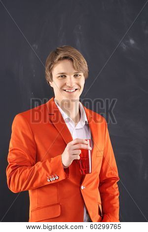 Smiling young worker with red mug