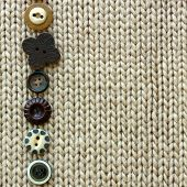 picture of tan lines  - a row of natural colored vintage sewing buttons are lined up framing tan tweed fabric square background - JPG