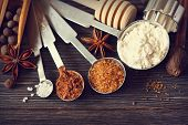 stock photo of spice  - Food ingredients and kitchen utensils for cooking on a wooden board - JPG