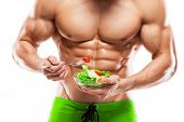 picture of abdominal muscle  - Shaped and healthy body man holding a fresh salad bowl isolated on white background colored retouched - JPG
