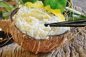 pic of boil  - boiled rice with lemon juice and fresh coconut in coconut empty - JPG