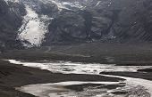 Iceland. South Area. Eyjafjalajokul Glaciar Tongue, River And 4Wd Vehicle.