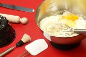 picture of confectioners  - cake mixture and confectioner utensils over red - JPG