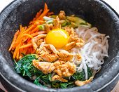 pic of korean  - Bibimbap korean food in black stone bowl